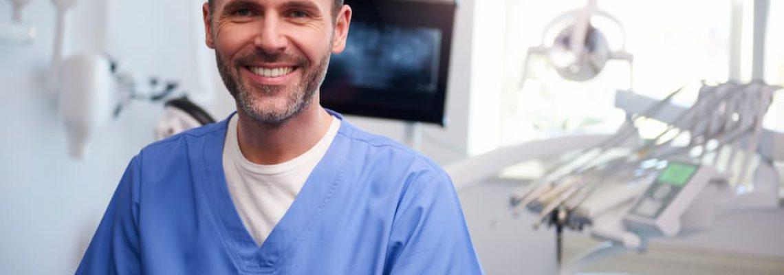 portrait-of-smiling-dentist-in-dentists-office-N2YXDVN (1)